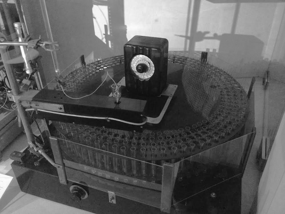 Original rotating fraction collector used by Moore and Stein for analysis of RNAse. RU historic instrument collection, accession number 105.